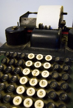 Photo of an old adding machine by Boise, ID photographer Benjamin Earwicker.  Oh, my aching fingers...
